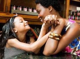 mother_and_daughter_holding_hands_in_cafe_is09973y4-645x450